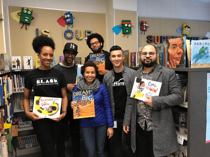 Affirm employees holding books