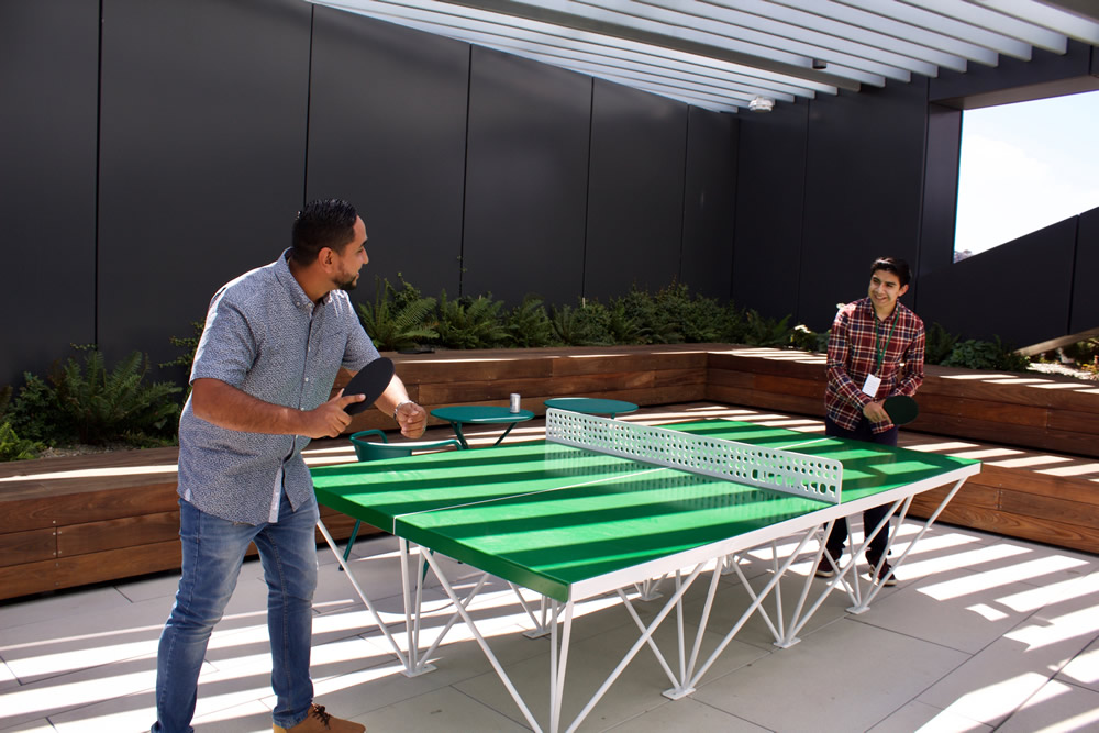 Intern playing pingpong with Dropbox